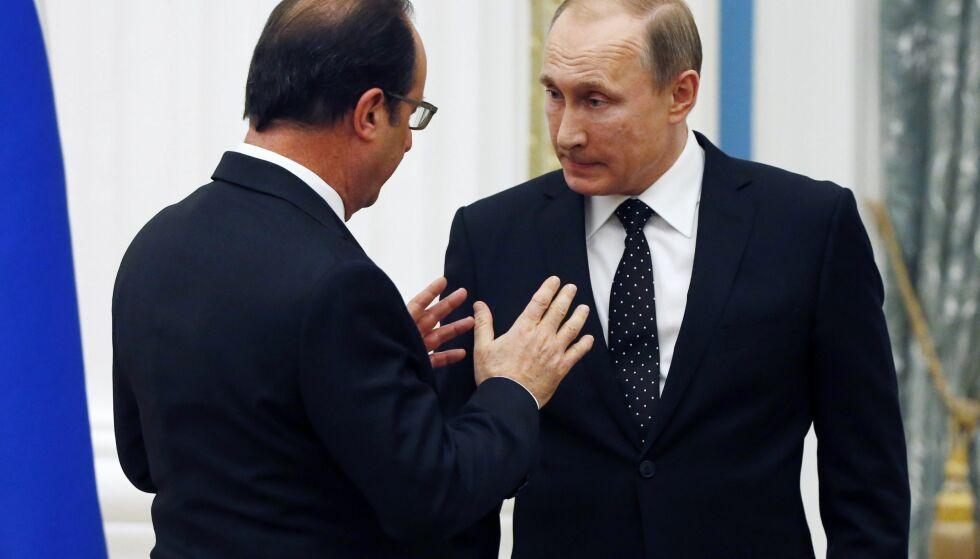 BESØK UAVKLART: Frankrikes president François Hollande har ennå ikke avgjort om han vil ha besøk av Russlands president Vladimir Putin. Foto: EPA / SERGEI CHIRIKOV / NTB scanpix