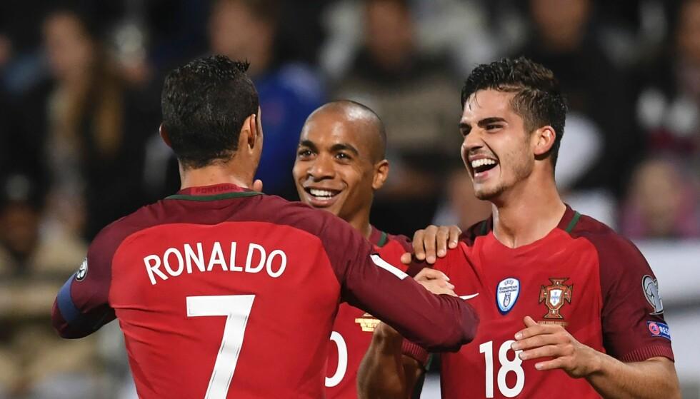 JUBLET SAMMEN: Andre Silva (t.h.), Joao mario og Cristiano Ronaldo. Foto: NTB Scanpix