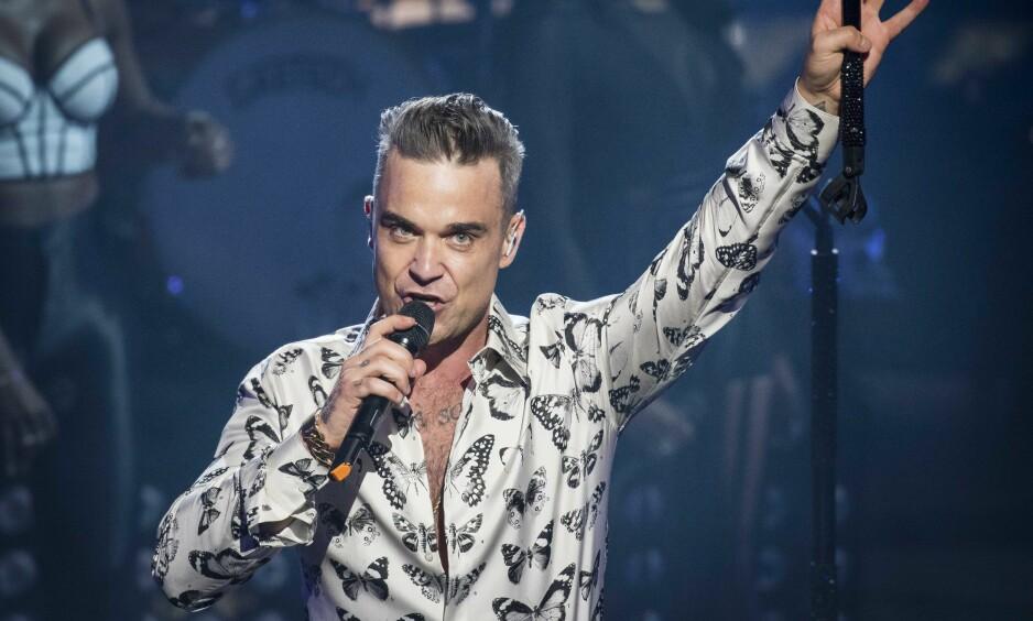 GIR IKKE OPP: Artist Robbie Williams har et dypt ønske om å få være med i et «Carpool karaoke»-innslag med James Corden. Foto: NTB Scanpix