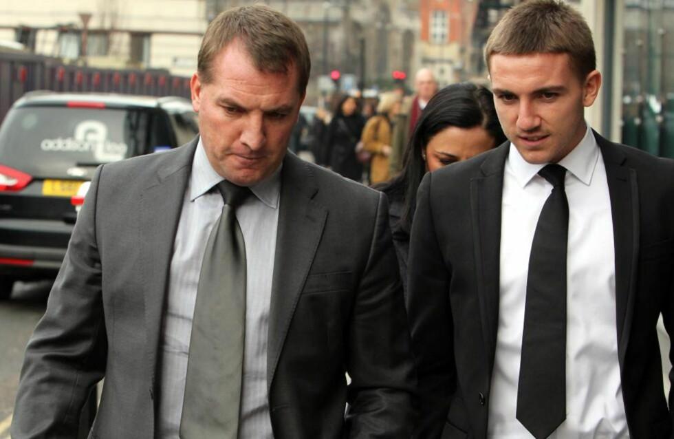 FULGTE SØNNEN I RETTEN: Liverpool-manager Brendan Rodgers var med sønnen Anton under første dag av rettssaken mot ham og tre andre fotballspillere i går. Foto: Sean Dempsey/PA