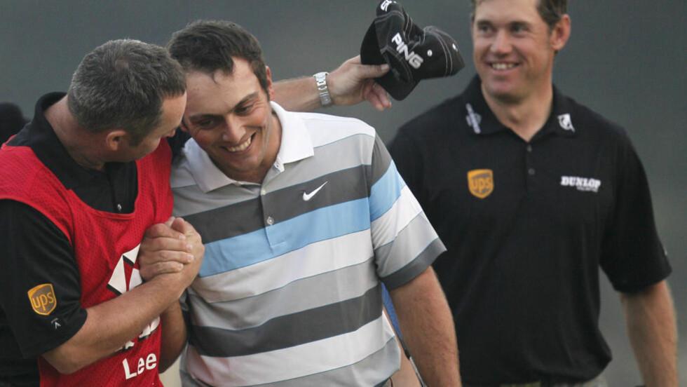 KJEMPET I FIRE DAGER:  Francesco Molinari kunne juble for seier i WGC-turneringen i Shanghai etter en spennende duell med verdensener Lee Westwood. Foto: (AP Photo/Andy Wong)