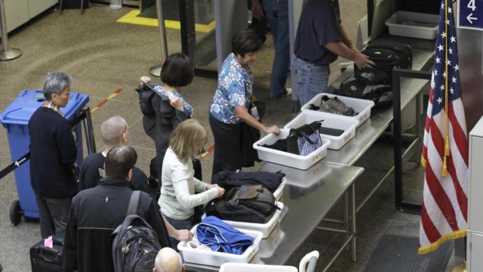 VARSLER KAOS:  En boikottaksjon mot kroppskannere kan skape kaos på amerikanske flyplasser på onsdag - dagen før thanksgiving og en av de største utfartsdagene i USA: Her en forsmal på onsdagens køer fra flyplassten i Seattle-Tacoma sist fredag. FOTO: AP/SCANPIX.