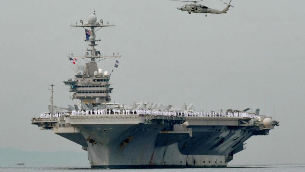 KAN STARTE KRIG: Superhangarskipet USS George Washington skal etter planen være med på en militærøvelse sammen med Sør-Korea fra søndag. Foto:    AFP Photo/Jay Directo/Scanpix