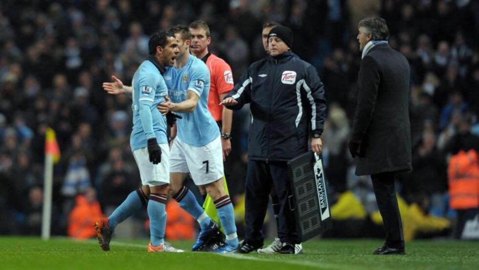 KJEKLING: Carlos Tevez reagerte skarpt på å bli byttet ut av Roberto Mancini lørdag, spissen er blitt erstattet 11 ganger så langt denne sesongen. Foto: EPA/ROBIN PARKER