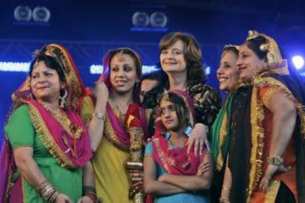 Cherie Blair, center, wife of Britain's former Prime Minister Tony Blair, and President of the Loomba Trust, poses for pictures with members of a traditional dancing group, prior to the Bollywood and International Music Concert in central London's Trafalgar Square, Monday June 23, 2008 to mark International Widows Day. (AP Photo/Lefteris Pitarakis)
