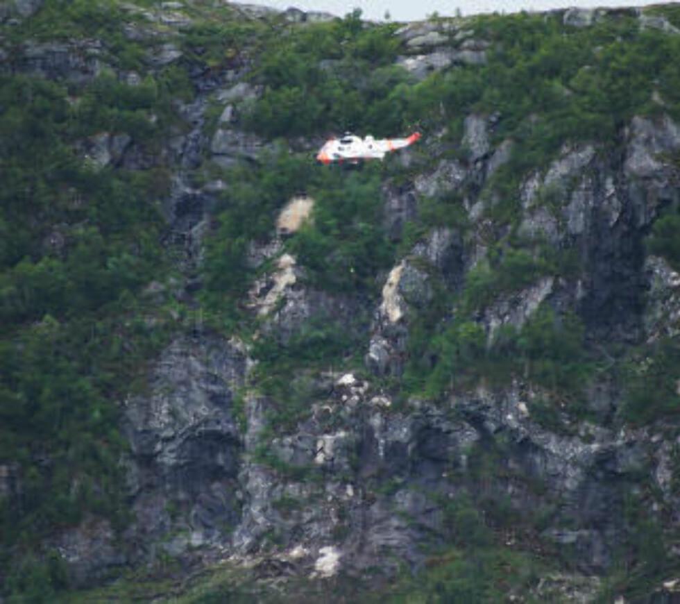 STUPBRATT: Svensken ble sittende fast på ei fjellhylle rett ved et stup på 50 meter. Foto: CHARLOTTE FØRDE