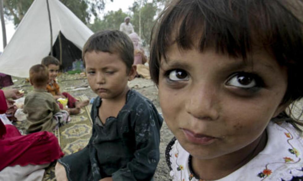 <strong>12 MILLIONER BERØRT:</strong>  Det verste regnet på mange tiår har ført til en av de verste katastrofene i Pakistans historie. Foto: AP Photo/Mohammad Sajjad