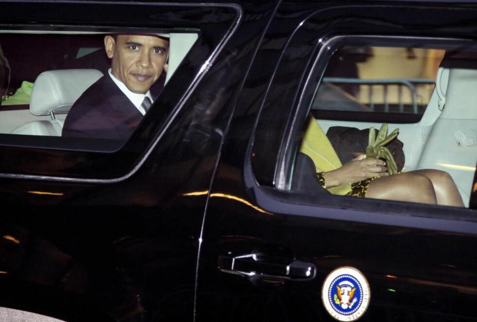 VINNERBILDET: USAs president Barack Obama med kona Michelle Obama i bilen på vei fra prisutdelingen. i Rådhuset - og er kåret til «Årets bilde».  Foto:  Hans Arne Vedlog / Dagbladet