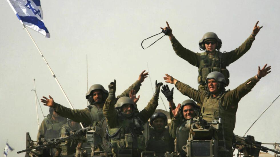 JUBLET FOR GJENKOMSTEN: Israelske soldater etter hjemkomsten fra Gazakrigen 16. januar 2009. Foto: AP/Anja Niedringhaus