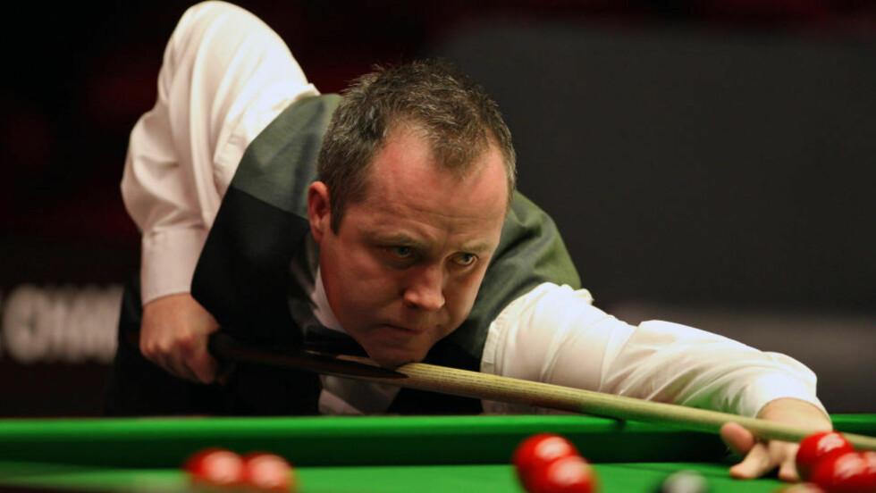 I TRØBBEL: Den skotske snooker-verdensmesteren John Higgins blir avslørt som kampfikser av News of The World.Foto: SCANPIX/AFP/ JAMES BAYLIS