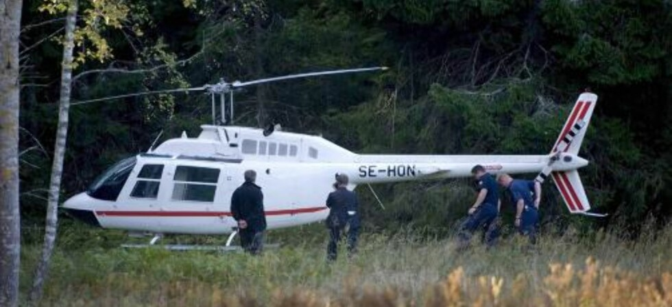 BESTE SPORET: Dette helikopteret er politiets beste spor etter ranerne.  EPA/SCANPIX
