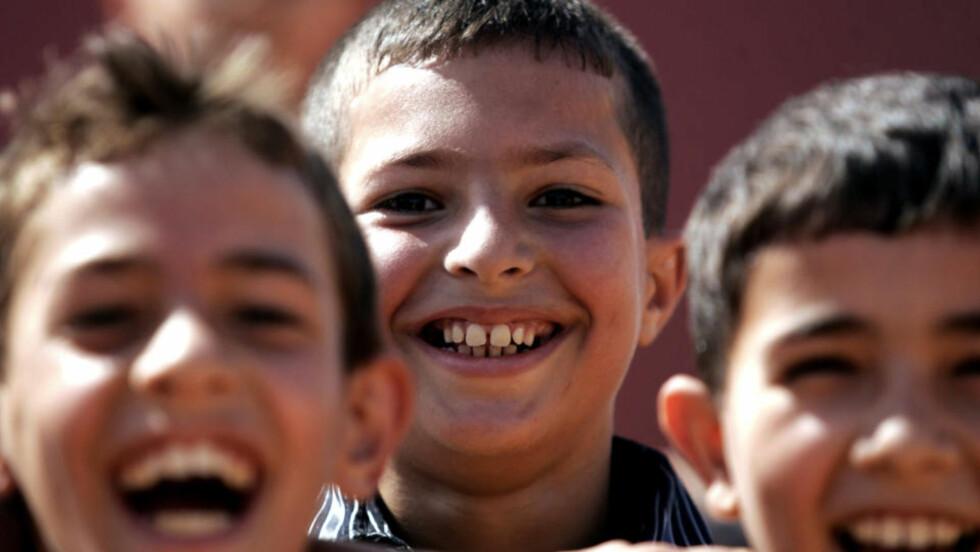 EN AV FIRE: Muslimer utgjør hver fjerde person i verden, viser ny rapport. Disse palestinske guttene feirer Eid i Jenin på Vestbredden i september i år.Illustrasjonsfoto: AFP PHOTO/SAIF DAHLAH