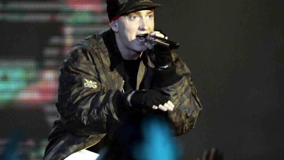 LEVERER VARENE: Eminem leverer med «Relapse» et morsomt sus fra fortida. Han og Dr. Dre gjør det de kan best. Foto: AP/Scanpix