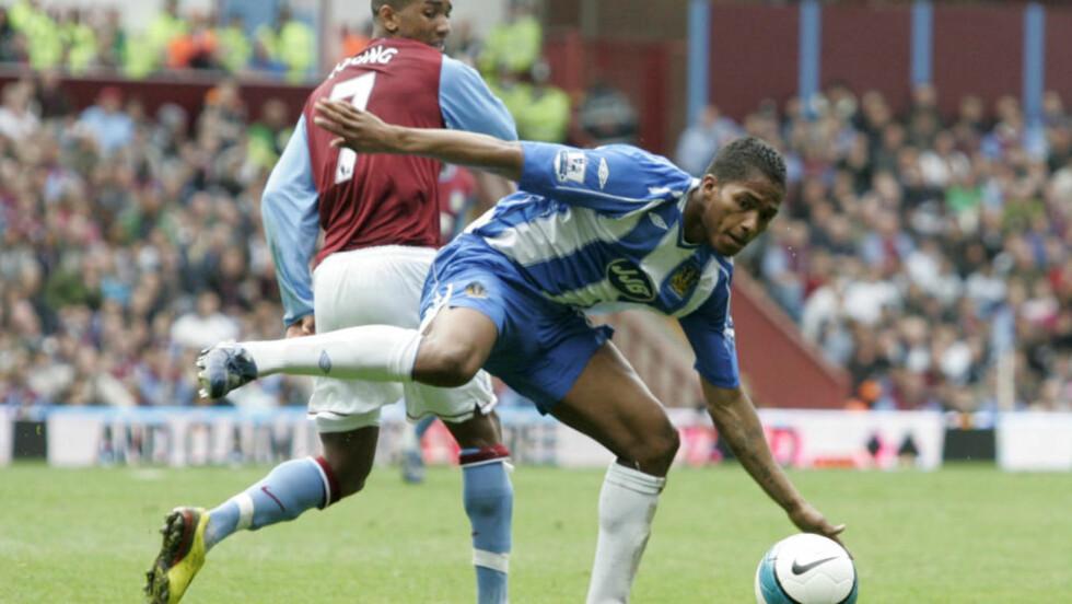 UNITED VIL HA VALENCIA: Wigan bekrefter at de har mottatt et konkret bud på Antonio Valencia (t.h.).Foto: Ian Kington, AFP/Scanpix