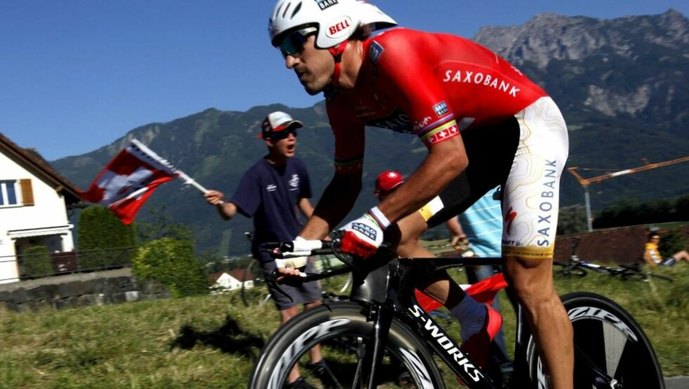 epa01760421 Switzerland's Fabian Cancellara from team Saxo Bank, is on his way to win the 1st stage, a 7,8 km race against the clock, from Mauren to Ruggell, at the 73nd Tour de Suisse UCI ProTour cycling race, in Ruggell, Liechtenstein, 13 June 2009.  EPA/JEAN-CHRISTOPHE BOTT