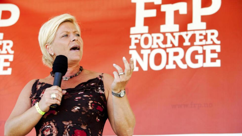SETTER BETINGELSER: Frp's formann Siv Jensen, her på partiets sommerleir i Bø i helga. Foto: TORE MEEK/SCANPIX