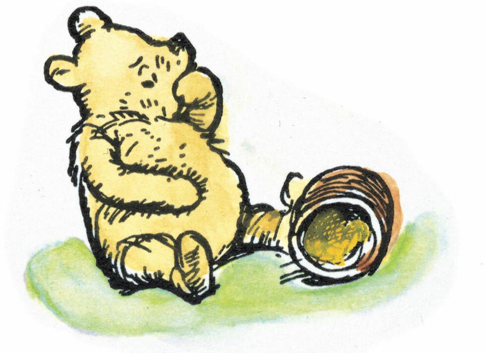 ALLERGIFRI: Den originale Ole Brumm i E.H Shepards penn. Den lille bjørnen hadde kanskje ikke så liten forstand likevel. Nå mener finske forskere å ha avdekket nye vidunderlige egenskaper i honning.  Foto: REUTERS/The Estate Of E.H. Shepard/SCANPIX