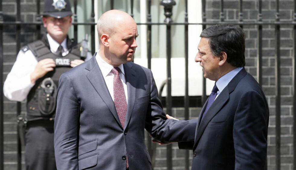 SKAL SAMARBEIDE: Sveriges statsminister Fredrik Reinfeldt og EU-kommisjonens president Jose Manuel Barroso er enige om at klimaspørsmålet blir et av de viktigste når Sverige overtar formannskapet i EU fra i dag. Foto: AFP/SCANPIX