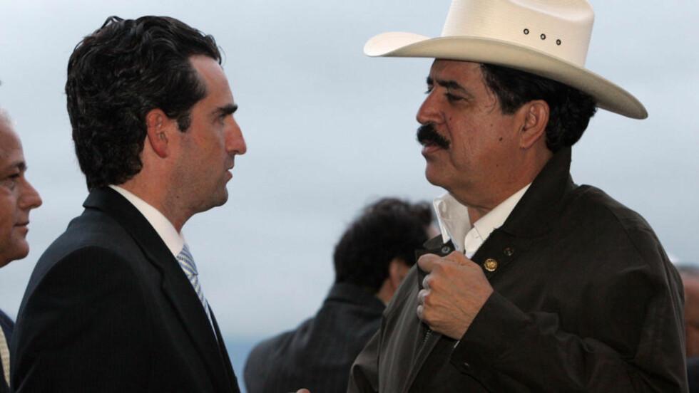 OFFENSIV:  Honduras' valgte, men kuppede president Manuel Zelaya (med hatt) ble møtt av Costa Ricas utenriksminister Bruno Stagno på flyplassen i San Juan. Foto: AP/SCANPIX.