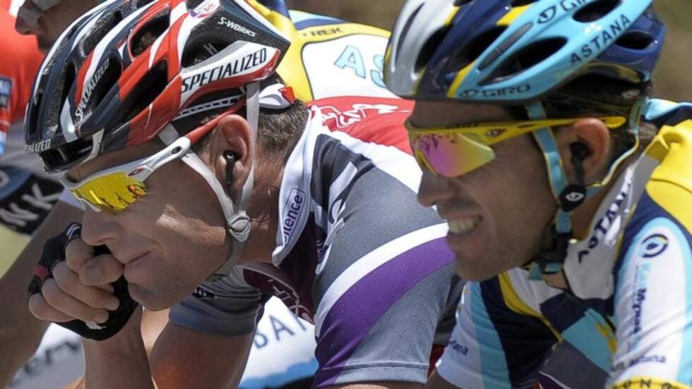 SPISSER KLØRNE: Alberto Contador og Astana har kontrollert hovedfeltet fullstendig den siste uka, men nå varsler rivalene at det er slutt på avslappet moro. I alpene kan det smelle. Foto: SCANPIX/EPA/NICOLAS BOUVY