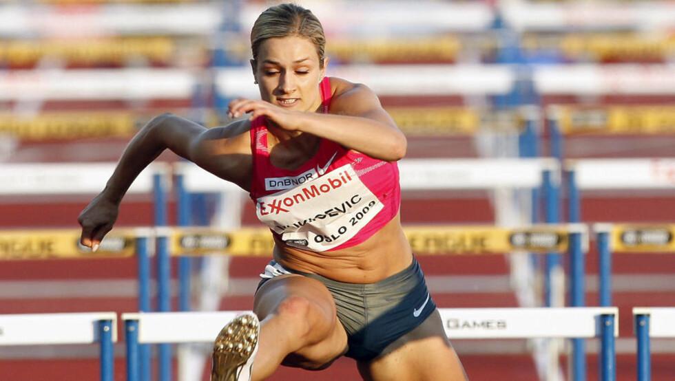 TOK GULL: Christina Vukicevic utklasset alle konkurrentene på 100 meter hekk, og løp inn til EM-gull. Her i aksjon på Golden League 100 m hekk under Bislett Games i Oslo. Foto: Tor Richardsen / SCANPIX .