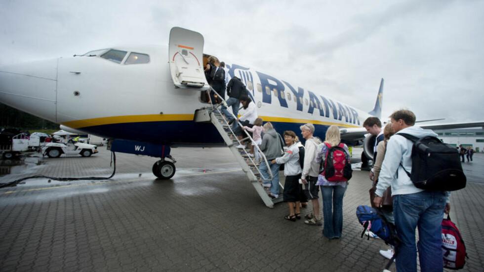 PRISBEVISSTE: Dagbladet snakket med 40-50 passasjerer på vei til Birmingham fra Sandefjord Lufthavn i går kveld. Alle hadde valgt Ryanair på grunn av lave priser. Foto: John Terje Pedersen