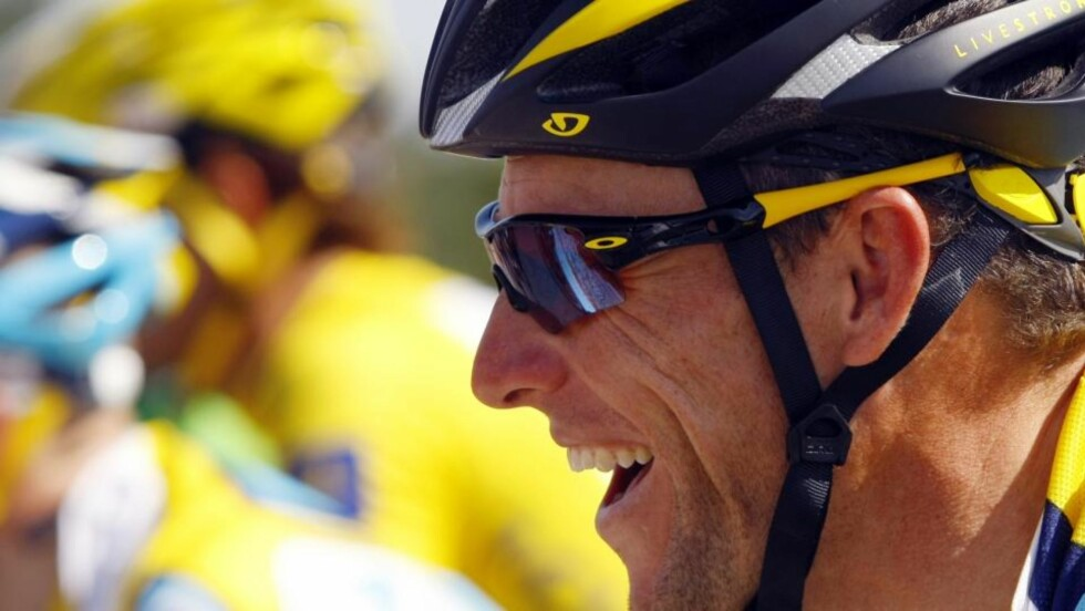 KAN SMILE: Nå er Lance' nye sponsor klar. Foto: REUTERS/Bogdan Cristel/Scanpix