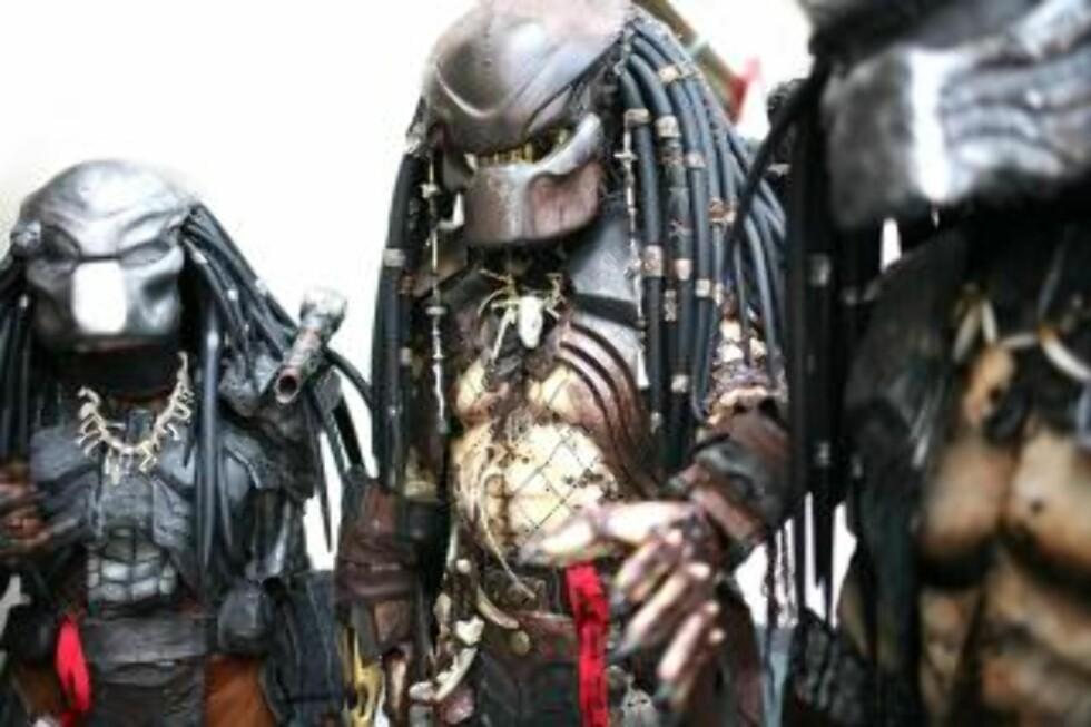 FANS: Massevis av filminteresserte inntok Comic-Con. Her er en gjeng utkledd som Predator. Foto: EPA/SEAN MASTERSON