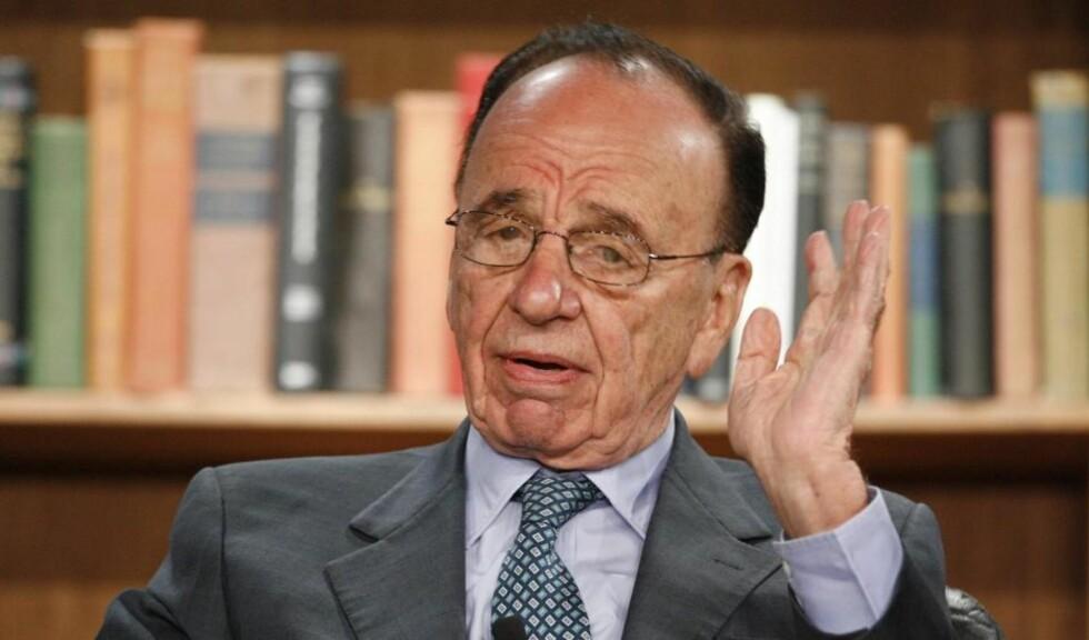 BETALING: Rupert Murdoch er verdens mektigste mediemogul. Nå vil han ta betalt av brukerne for nettstedene sine, deriblant MySpace og spilltjenesten IGN.com. Foto: SCANPIX