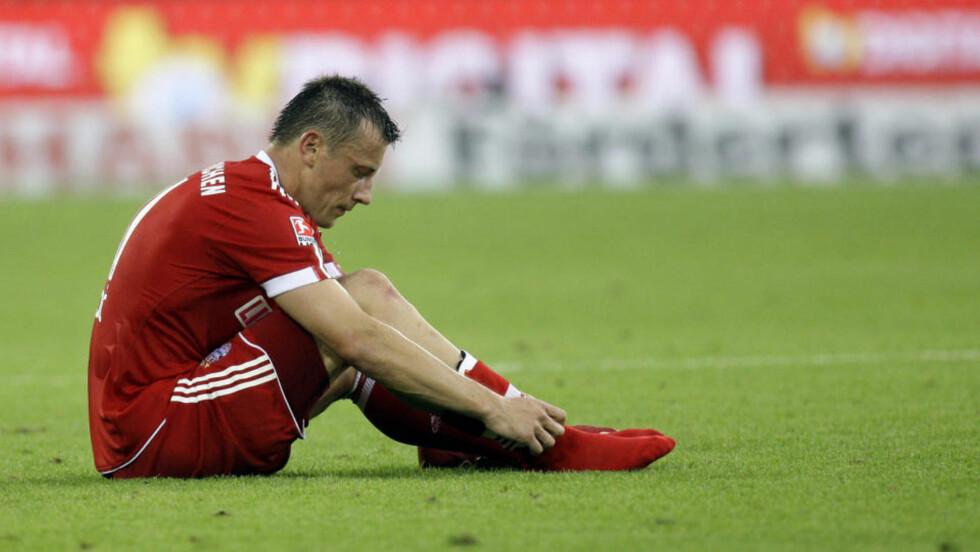 SKUFFENDE PREMIERE: Bayern Münchens målscorer Ivica Olic depper etter kampslutt da en skadeskutt gullutfordrer skuffet i seriepremieren med 1-1 borte mot Hoffenheim.Foto: SCANPIX/REUTERS/Thomas Bohlen