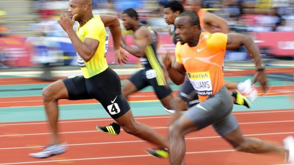 FIKK BESKJED? Jamaicas Asafa Powell (t.v) mener han ikke hørte om treningsleiren. Her fra 100 meteren i London i juli. Foto: REUTERS/Dylan Martinez