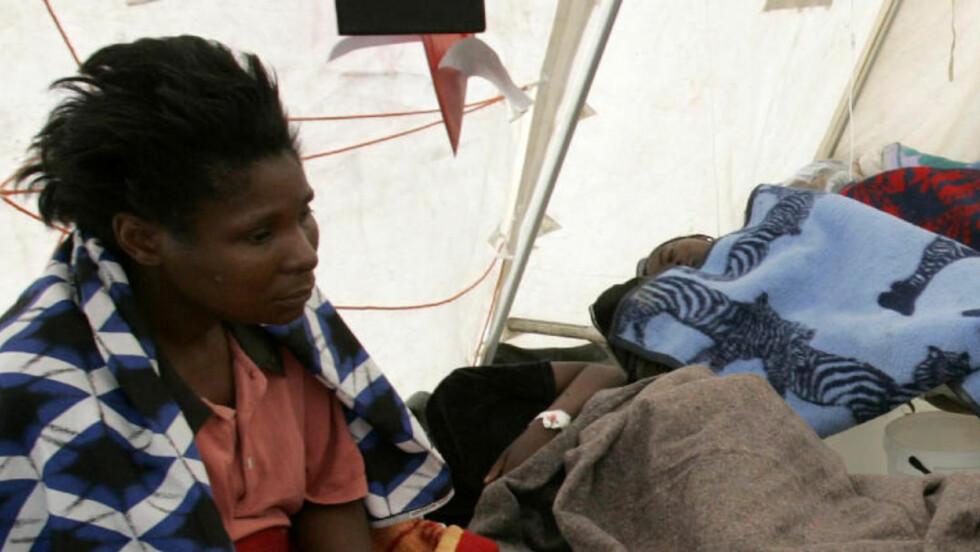 60.000 SKAL VÆRE SMITTET AV KOLERA I ZIMBABWE: President Robert Mugabe hevder denne uken at det ikke fins noen kolera i landet. Foto: REUTERS/Philimon Bulawayo (ZIMBABWE)