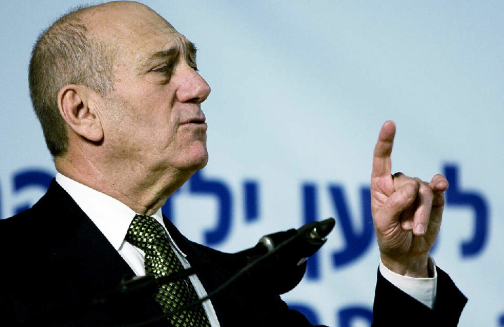 MANGE FORBEHOLD: Israelske styrker blir værende i Gaza, og statsminsiter Ehud Olmert lover å slå tilbake om Hamas fortsetter med rakettskyting.