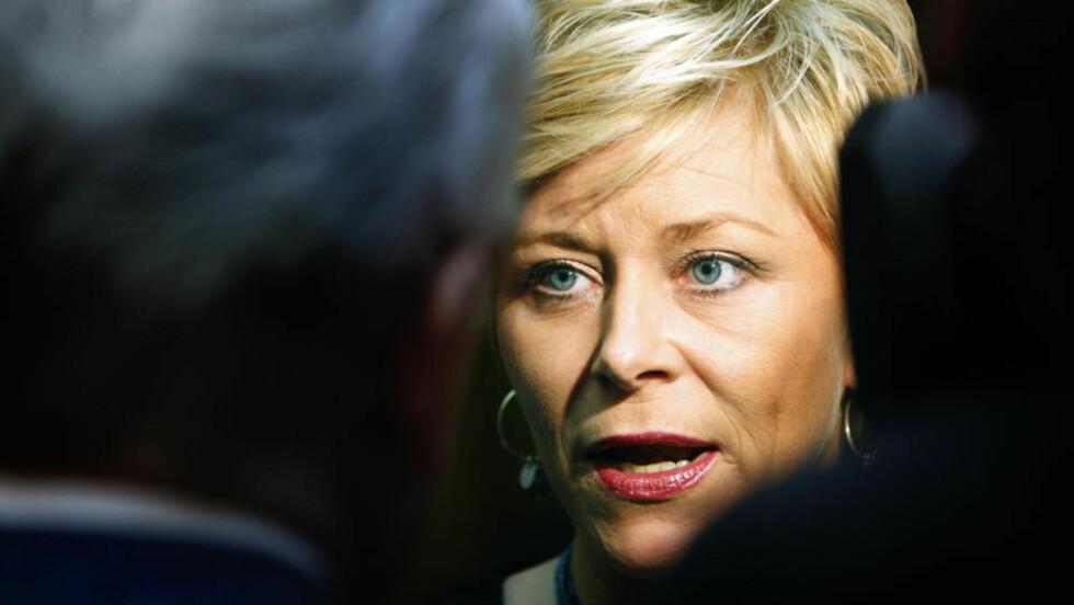 KLAR TALE: Fremskrittspartiets formann Siv Jensen har høstet storm for talen hun holdt under partiets landstyremøte lørdag. Foto: Lise Åserud / SCANPIX