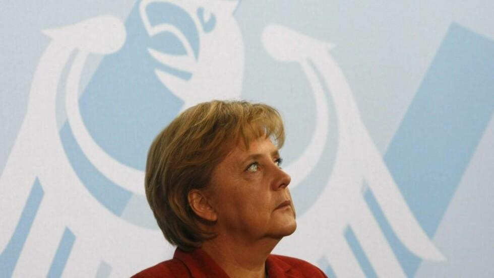 MEKTIG KVINNE: Tysklands forbundskansler Angela Merkel er trolig verdens mektigste kvinne. Men den folkevalgte verden er langt i fra likestilt. Foto: REUTERS/Fabrizio Bensch/SCANPIX
