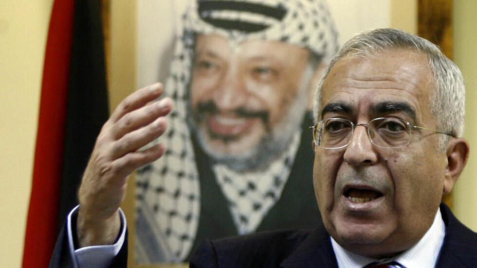 GÅR AV: Salam Fayyad. Foto: AFP PHOTO/AHMAD GHARABLI/Scanpix