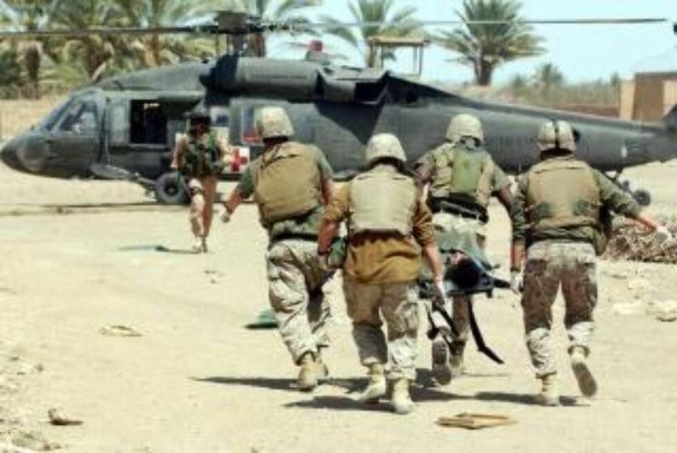 INVASJON: US Marines i Ar Ramadi. Kvinner lider under invasjonen, ifølge en ny rapport. Foto: Maurizio Gambarini/EPA/Scanpix