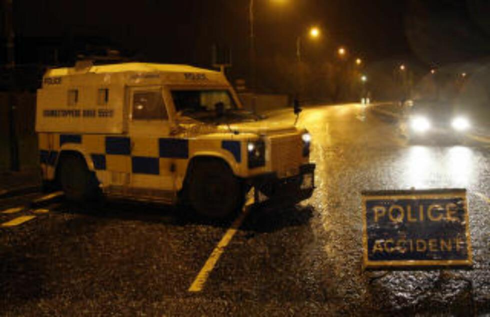 SPERRET AV: Politiet sperret av området etter drapet. Foto: AP/Peter Morrison/Scanpix