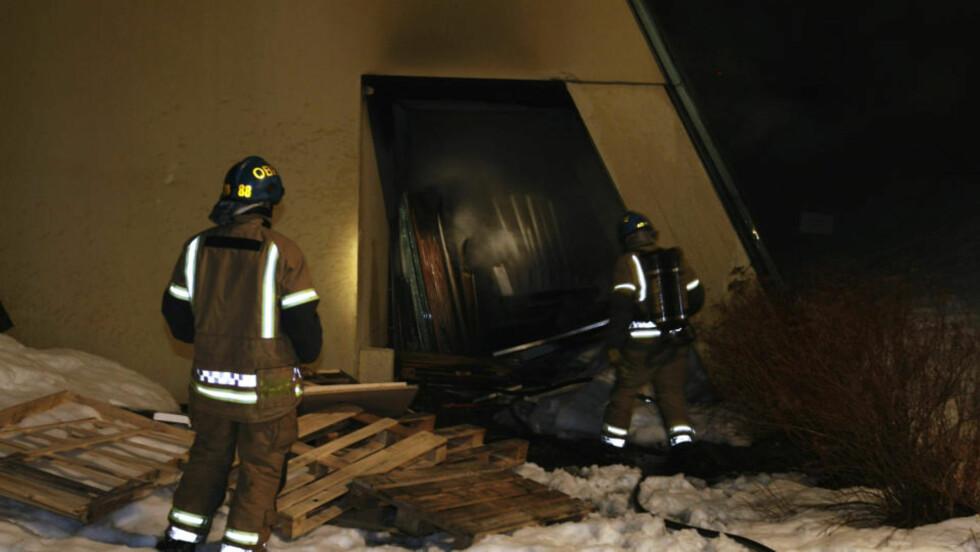 BRANN I SIDEBYGG:  Brannvesenet slukket onsdag kveld en brann i et sidebygg i Fram-museet. Foto: Terje Bendiksby/ Scanpix