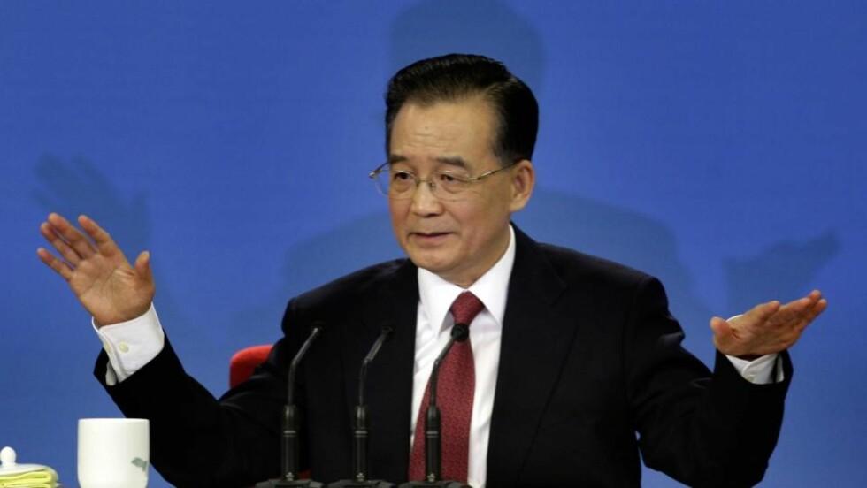 BEKYMRET OPTIMIST: Kinas statsminister Wen Jiabao er bekymret for Kinas store lån til USA, men tror Kina og verden vil ha det bedre til neste år.  Foto: SCANPIX
