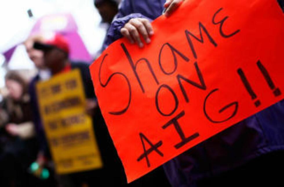 DEMONSTRASJONER: Amerikanerne er rasende på AIG. Her fra en demonstrasjon i Washington. Foto: Win McNamee/Getty Images/AFP/Scanpix