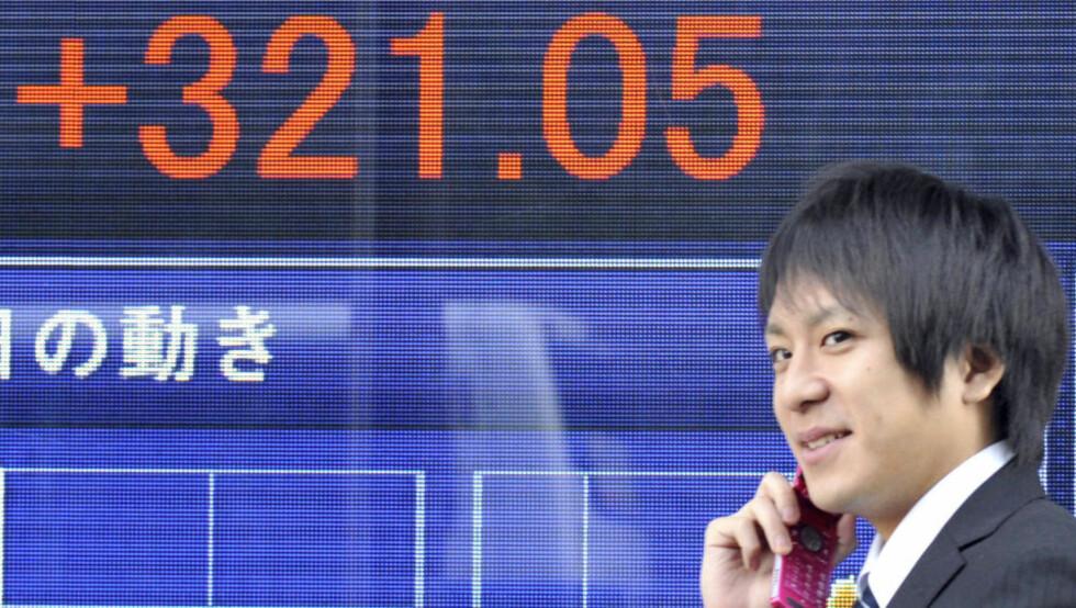 OPPGANG I DAG: Positive børstall i Asia. Foto: AFP PHOTO/Yoshikazu TSUNO/Scanpix