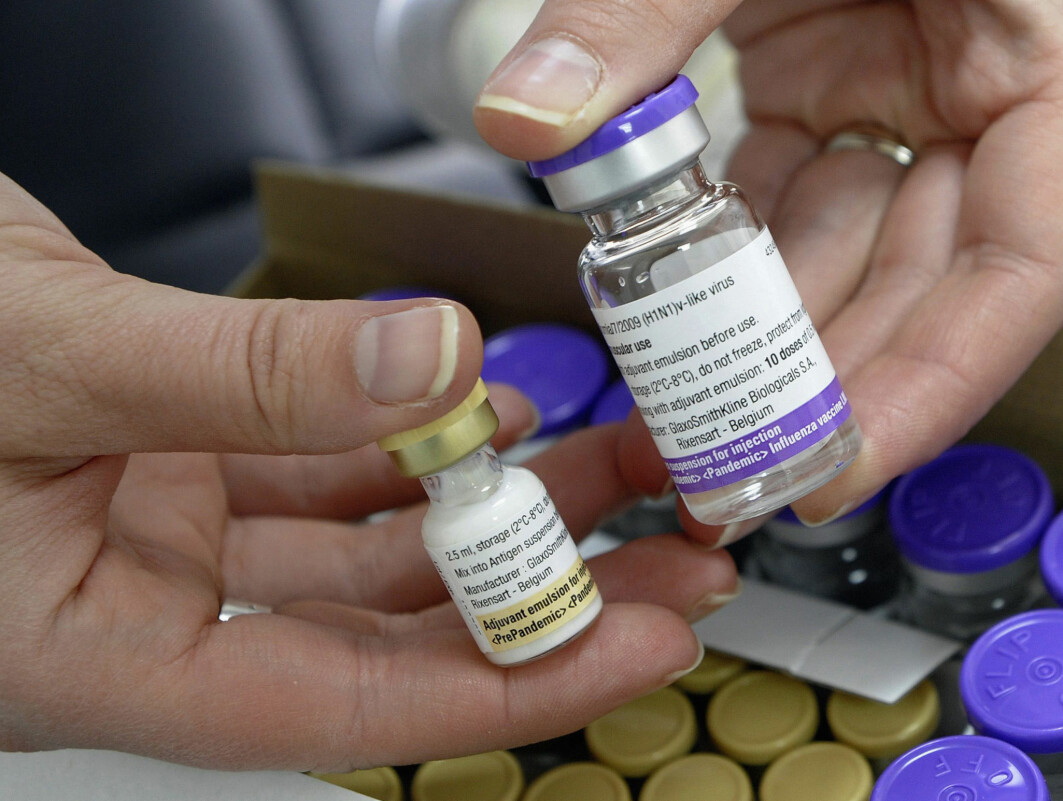 """A nurse holds a bottle of the Pandemrix H1N1 flu vaccine (R) and a bottle of the vaccine's adjuvant (L) at a health centre in Burgos in this November 16, 2009 file photo. GlaxoSmithKline's Pandemrix swine flu vaccine has been linked to cases of the rare sleep disorder narcolepsy in children in a scientific study in England that confirms similar findings elsewhere in Europe. The vaccine, more than 30 million doses of which were given during the H1N1 flu pandemic in 2009-2010, contains a booster, or adjuvant, and may have triggered an adverse immune reaction in some children at higher genetic risk of narcolepsy, scientists said in new research published on Wednesday. Researchers at Britain's Health Protection Agency (HPA) who published the study in the British Medical Journal said the at least 14-fold increased risk they found had """"implications for the future licensing and use of adjuvanted pandemic vaccines"""". Picture taken November 16, 2009.      REUTERS/Felix Ordonez/Files (SPAIN - Tags: DRUGS SOCIETY HEALTH SCIENCE TECHNOLOGY BUSINESS)"""