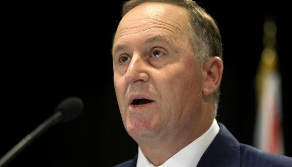 SJOKKAVGANG: New Zealands statsminister John Key, kunngjorde natt til mandag at han går av. Han begrunner den overraskende avgangen med hensynet til familien. Foto: AP / NTB Scanpix