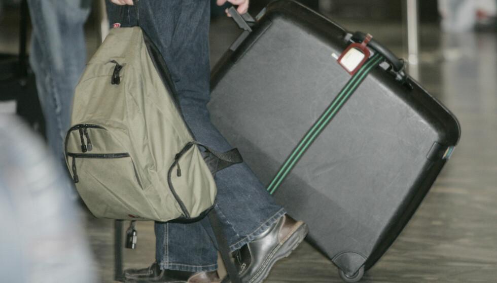 MER OG MER: Stadig større - og mer - håndbagasje er i ferd med å bli et problem for flere flyselskap. Lagringsplassen ombord er begrenset, og for mye bagasje kan forsinke både ombordstigning og avgang. Nå har United Airlines varslet at de vil innføre en hattehylle-avgift på sine rimeligste billetter. Foto: NTB Scanpix