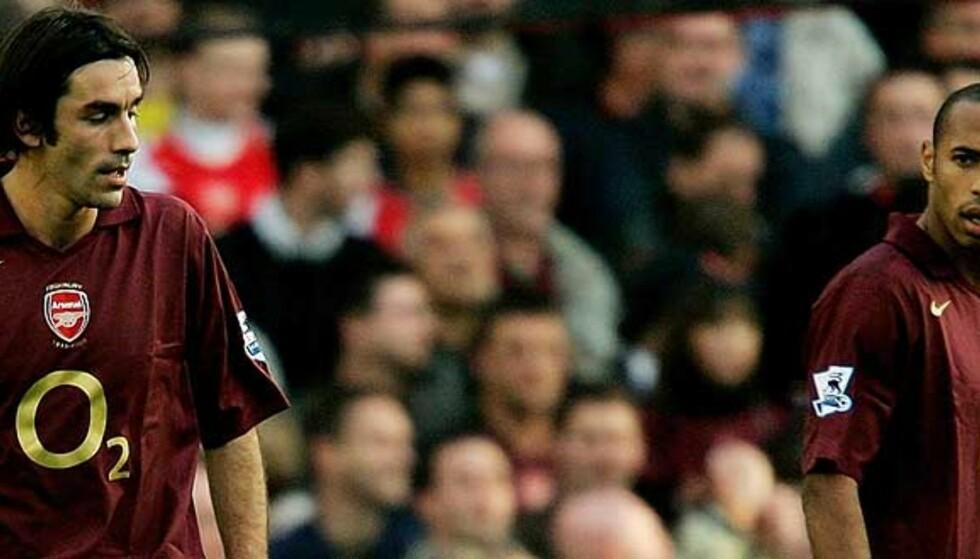MISFORNØYD: Thierry Henry ser ikke veldig fornøyd ut, etter at Robert Pires rotet bort Arsenals andre straffe. Foto: REUTERS