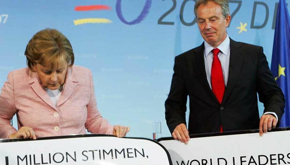 JOBBET TETT: Tony Blair sier han har jobbet tett sammen med forbundskansler Angela Merkel og president George W. Bush om å sikre en avtale under G8-møtet. Foto: AFP PHOTO DDP/MICHAEL KAPPELER/Scanpix