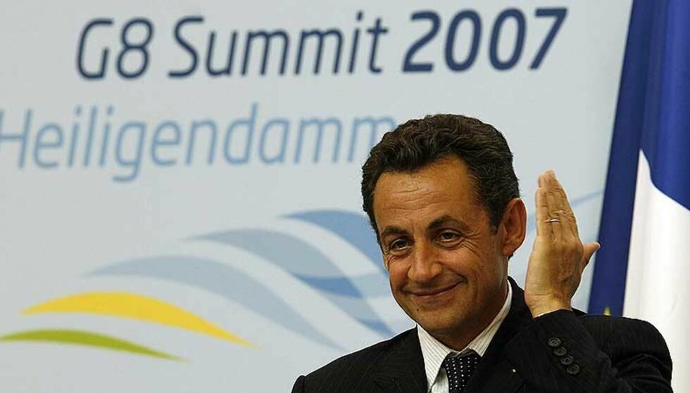 UENIGE: Frankrikes president Nicolas Sarkozy foreslo under G8-toppmøtet i Tyskland at man ikke skal presse fram noen avklaring om Kosovos status nå. Men det ble ikke oppnådd enighet blant G8-landene om å utsette avgjørelsen. Foto: REUTERS/Philippe Wojazer/SCANPIX