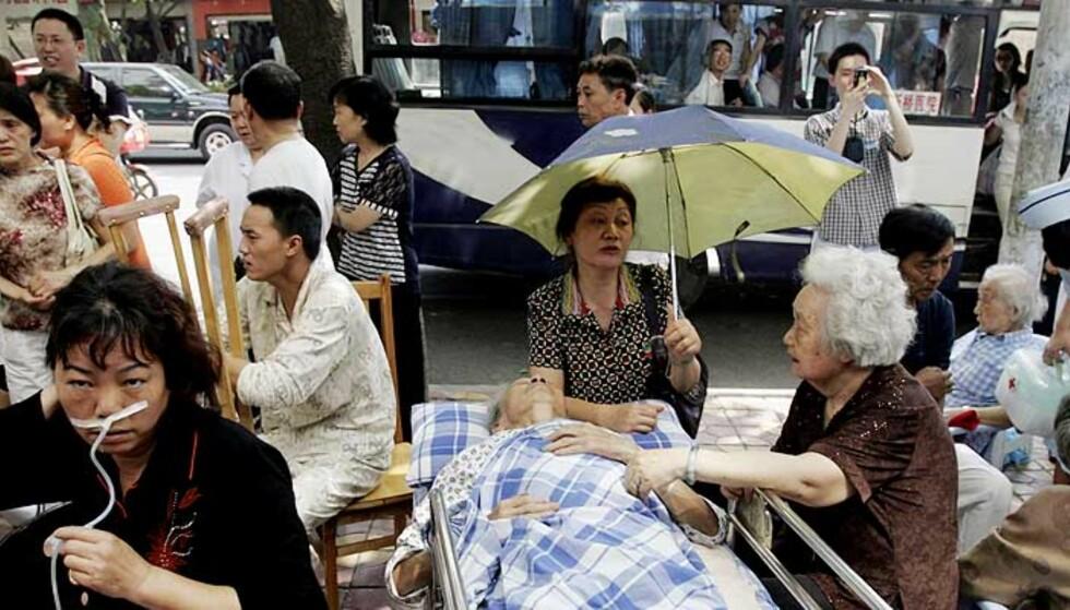 DØDSTALLENE STIGER: Over 7000 mennesker er bekreftet omkommet som følge av jordskjelvet. Myndighetene frykter at ytterligere 5000 mennekser kan være døde i Beichuan. 80 prosent av alle bygningsmassen har rast sammen. Foto: AP PHOTO/SCANPIX