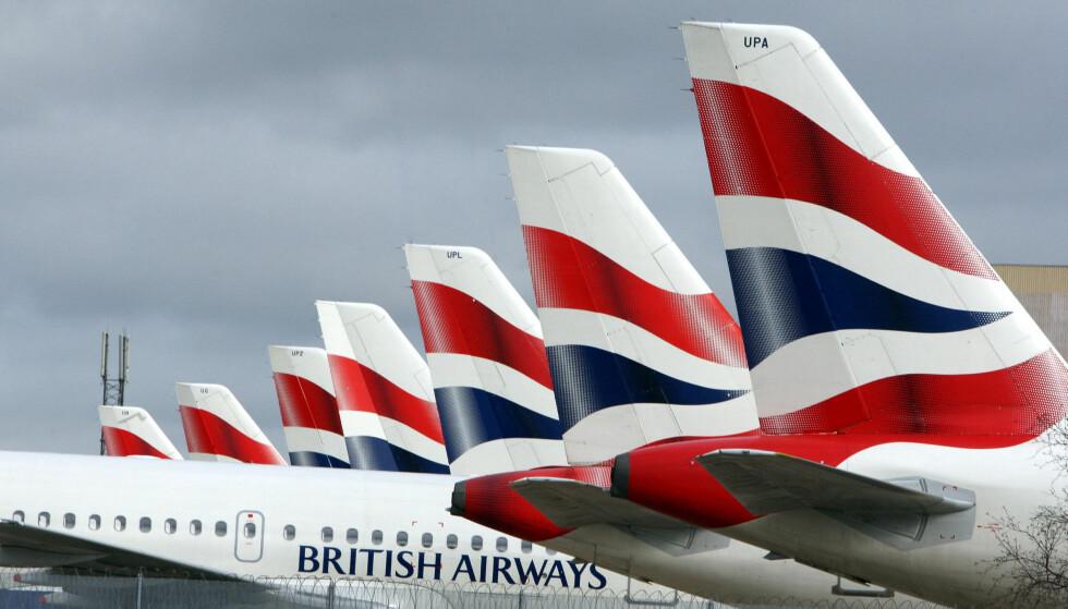 PÅ BAKKEN: British Airways risikerer at en rekke fly blir stående på bakken i jula. De kabinansatte på Heathrow har varslet streik. Foto: NTB Scanpix